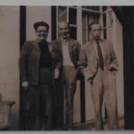 Louise Callender, Director of Heinemann & Fred Urquahant at Tring 1944. Rhys Davies on right.: Image 13